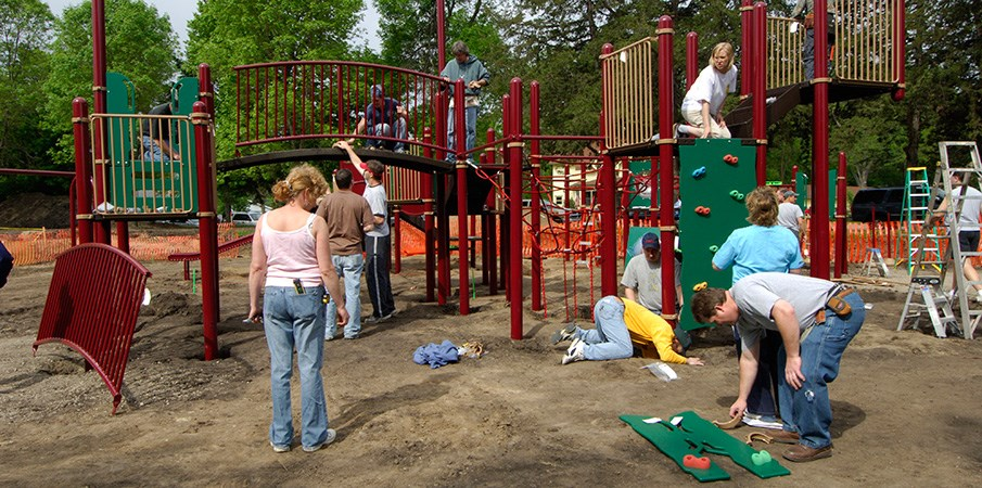 Volunteers building a PlayBooster playground.