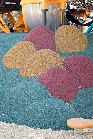 Stepping mounds covered in PebbleFlex playground surfacing.