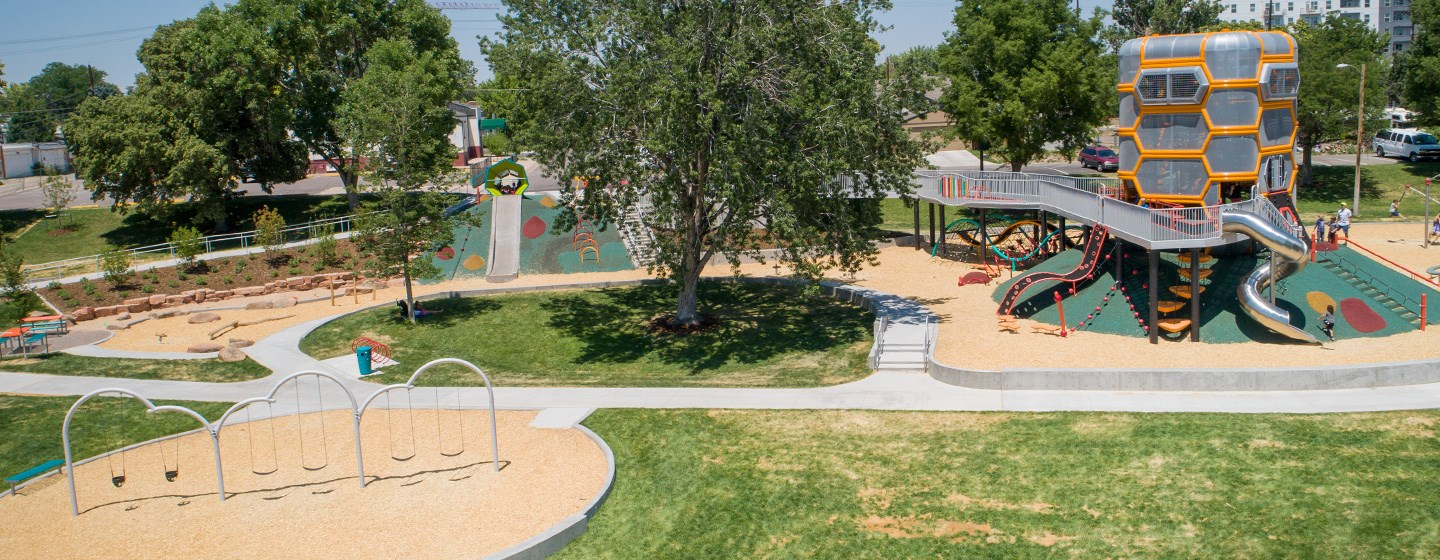 Elevated side view of the entire Paco Sanchez Park in Denver, Colorado with a microphone themed main playground structure.