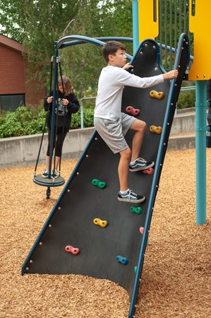 The Conical Climber™ is a cone-shaped angled wall climber that helps kids climb from the ground to PlayBooster® deck through a series of sturdy handholds.