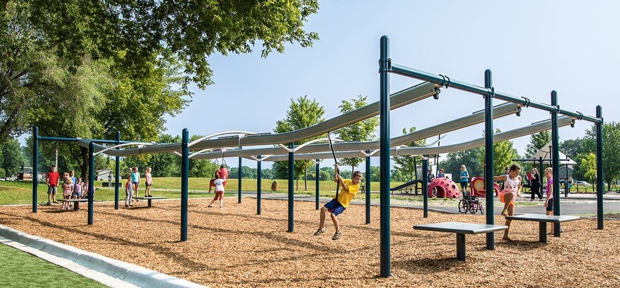 A playground zip track with a built-in elevation that offers a smooth, two-way ride for nonstop fun.