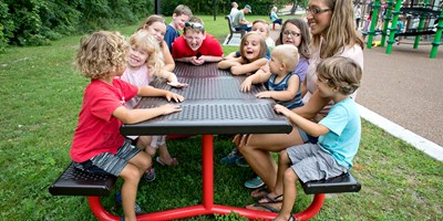 The TenderTuff™ Picnic Table provides an ideal place for kids to rest between spurts of play.