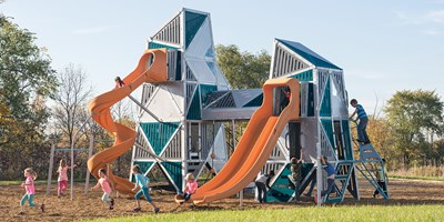 Children at play on the multiple towers of the Alpha Link Towers main structure. Includes chin up bars, climbers, elevated crawl tunnel in bright lagoon and tangerine colors.