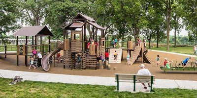 Wabun Picnic Area inclusive cabin themed playground in Minnehaha Regional Park in Minneapolis Minnesota.
