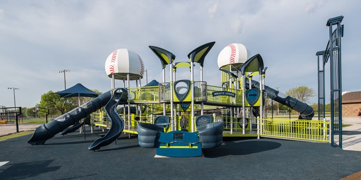 Two story inclusive playground with custom baseball tower roofs at the Ankeny Miracle Park.