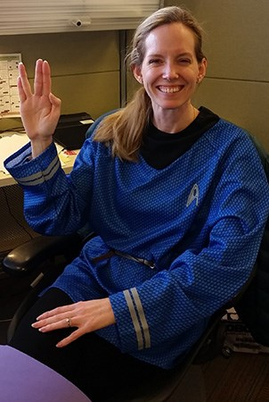 Landscape Structures Lora Geiger holds her hand up with a Vulcan salute while wearing a Star Trek Halloween costume.