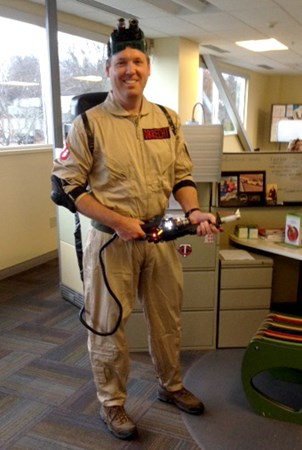 Landscape Structures Mark Obrecht poses for the camera in a Ghostbusters Halloween costume.