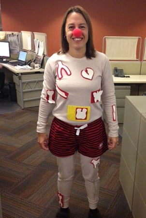 Landscape Structures employee Michelle Krenik dressed as the operation game man.