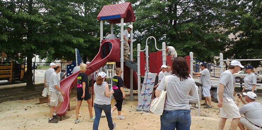 Volunteers building a playground.