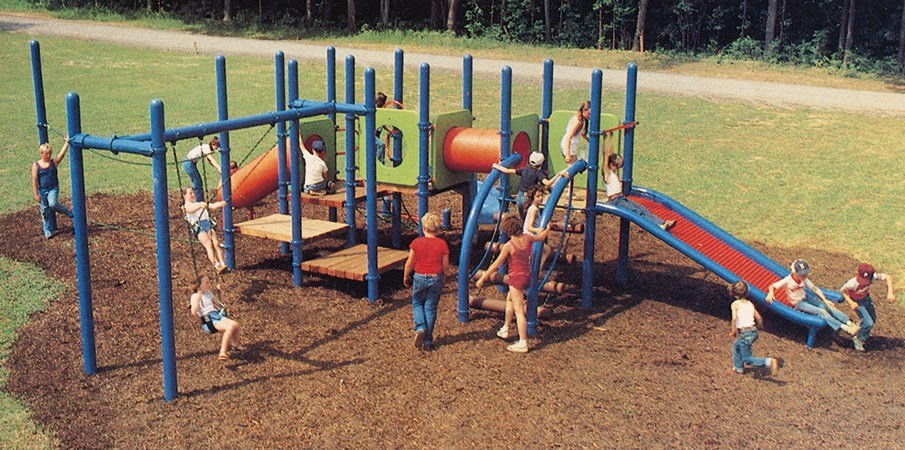 Children playing on an early Landscape Structures playground.