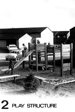 Black and white photo of a Landscape Structure first wood playground.