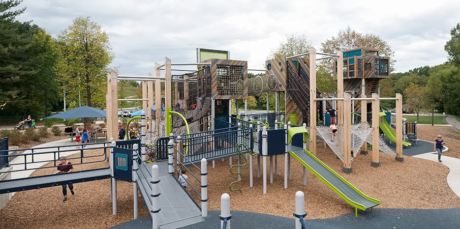 View of the inclusive wheelchair ramps onto the French Regional Park playground.