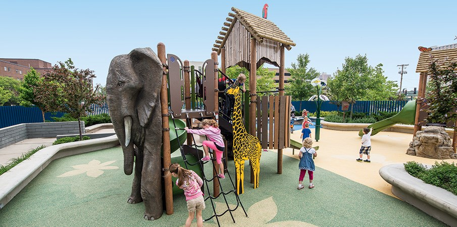 Children playing on a animal themed playground.