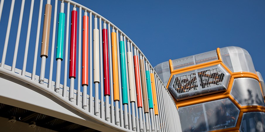 Colorful ADA ramp railing up to the playground tower.