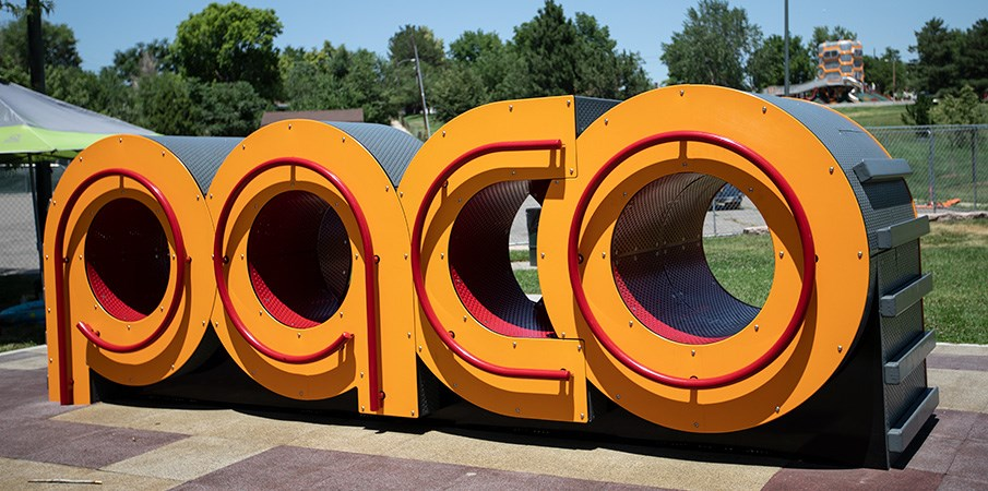 "Life size letters reading ""PACO"" with climbing rungs and railing."