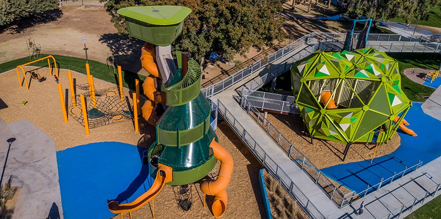 Aerial view of the Pioneer Park playground structures and surrounding cargo net climbers and swings.