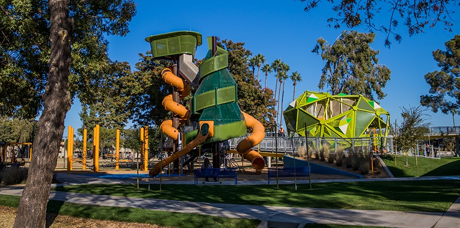 Full ground view of the Pioneer Park playground structures.