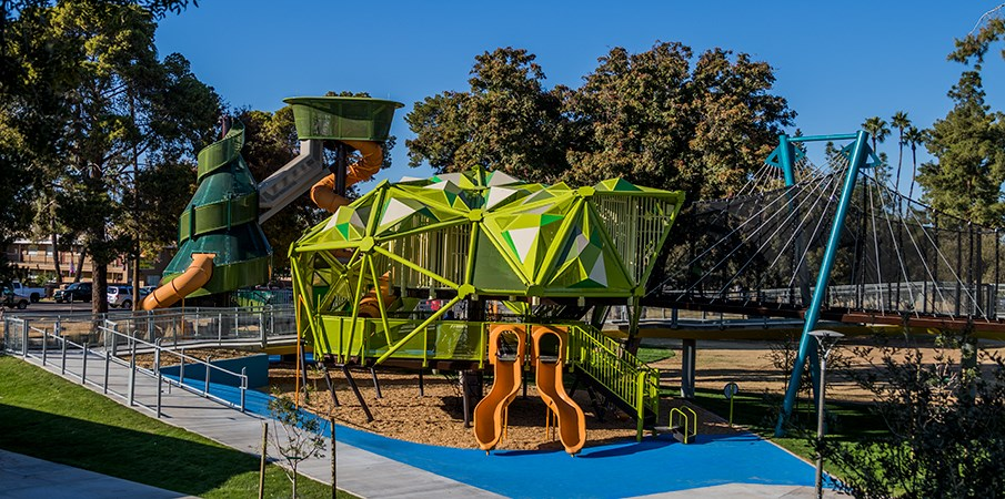 Elevated view of the pistache tree playground structure with SlideWinder and a Rushwinder slides.