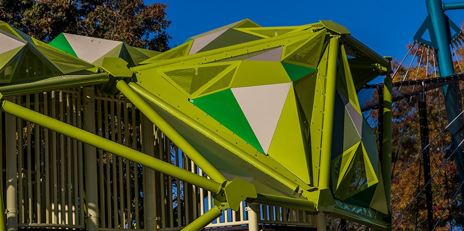 close up view of the unique geometrical shaped roof panels of the pistache tree playground structure.