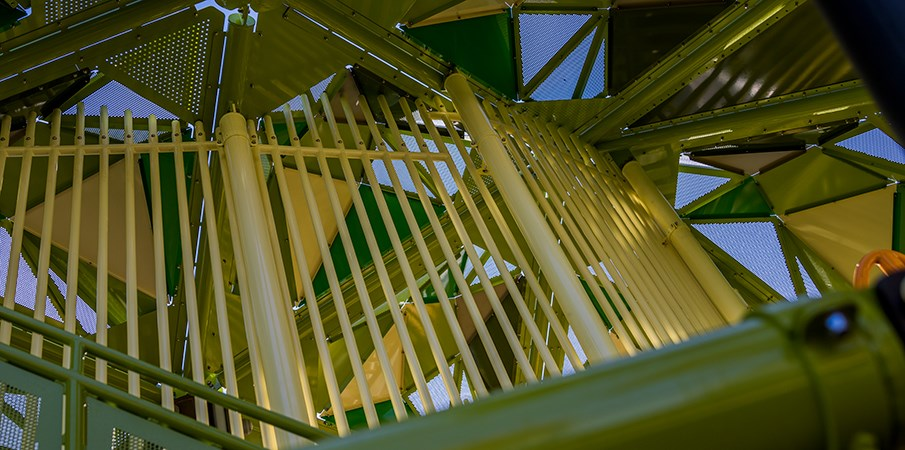 Vertical view of the inside of the pistache tree playground structure roof and support posts.