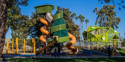 Side view of the custom themed tree designed playground structures at Pioneer Park in Mesa Arizona.