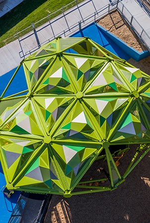 Aerial view of the top of the geometrical shaped roofing on the pistache tree playground structure.